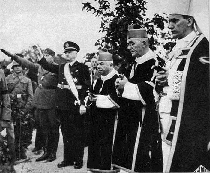 Ante Pavelić giving Nazi salute (far left) with Archbishop Alojzije Stepinac (far right) and other Catholic Church leaders