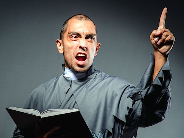 Angry Christian priest (Shutterstock)